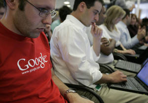 Photo - FILE - In this May 30, 2007 file photo, Google employees work on their laptops at Google headquarters in Mountain View, Calif. In a groundbreaking disclosure, Google on Wednesday, May 28, 2014 revealed how very white and male its workforce is — just 2 percent of its Googlers are black, 3 percent are Hispanic, and 30 percent are women. (AP Photo/Paul Sakuma, File)