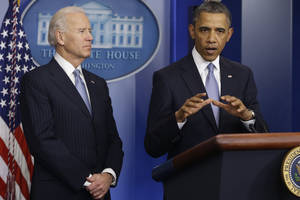Photo - President Barack Obama and Vice President Joe Biden make a statement regarding the passage of the fiscal cliff bill in the Brady Press Briefing Room at the White House in Washington, Tuesday, Jan. 1, 2013. (AP Photo/Charles Dharapak)