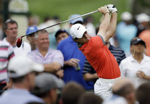 Photo - Rory McIlroy, of Northern Ireland, tees off on the 15th hole during the first round of the Memorial golf tournament Thursday, May 29, 2014, in Dublin, Ohio. (AP Photo/Darron Cummings)