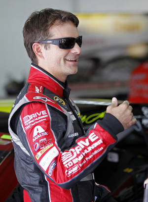 Photo - Jeff Gordon talks to crew members before practice for Sunday's NASCAR Sprint Cup series Coca-Cola 600 auto race at Charlotte Motor Speedway in Concord, N.C., Thursday, May 22, 2014. (AP Photo/Terry Renna)