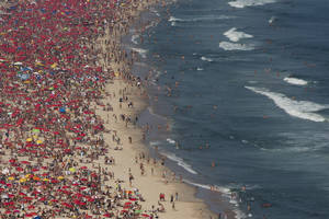 Photo -   This Sept. 7, 2012 photo shows sunbathers at Ipanema beach in Rio de Janeiro, Brazil. Rio boasts some of the world's most stunning urban beaches and they're worth several visits. (AP Photo/Felipe Dana)