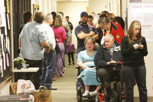 photo - Voters had about a 90-minute wait in line to cast their vote Tuesday at Church of Christ in Yukon.  Photo By Steve Gooch, The Oklahoman