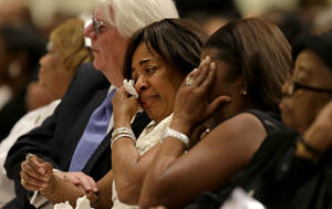 "Photo - Donna Kelly Pratte, mother of Chris Kelly of the rap duo Kris Kross, wipes a tear during the funeral for her son, Thursday, May 9, 2013, in Atlanta. The 34-year-old Kelly was found dead May 1 of a suspected drug overdose. Kriss Kross was introduced to the music world in 1992 by music producer and rapper Jermaine Dupri after he discovered the pair at a mall in southwest Atlanta. Kelly performed alongside Chris Smith, who known as ""Daddy Mac.""  (AP Photo/David Goldman)"