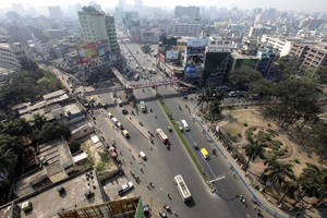 photo - A general view of Farmgate, one of the capital's busiest area, during a nationwide strike called by Bangladesh's largest Islamic party, Jamaat-e-Islami, in Dhaka, Bangladesh, Sunday, March 3, 2013. Authorities deployed soldiers in a northern Bangladeshi district on Sunday after Islamic party activists clashed with police, leaving five people dead during a nationwide general strike called to denounce war crimes trials. (AP Photo/A.M. Ahad)