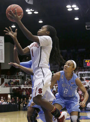 Photo - Stanford guard Lili Thompson (1) shoots against North Carolina guard Latifah Coleman (2) and forward Stephanie Mavunga, left rear, during the first half of a regional final of the NCAA women's college basketball tournament in Stanford, Calif., Tuesday, April 1, 2014. (AP Photo/Jeff Chiu)