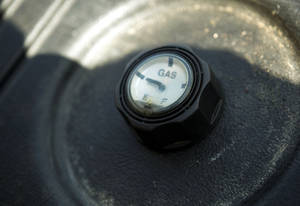 Photo - The gasoline cap to a generator a friend loaned Ken Steiner sits on empty after the last gallon was used to power his home at 1611 SW 20th St. in Moore as his power was finally returned on June 18, 2013. Photo by KT KING, The Oklahoman