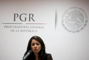 Photo - Mariana Benitez, Mexico's Assistant Attorney General speaks during a news conference in Mexico City, Thursday, April 4, 2013. Mexican prosecutors say they have broken up a plot by an armed gang to assassinate two federal legislators, a senator and a congressman, whom are also brothers from the north-central state of Zacatecas. According to Benitez, the armed gang was arrested Thursday at a hotel in downtown Mexico City. (AP Photo/Eduardo Verdugo)