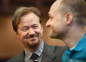 Photo - In this June 14, 2014 photo, Frank Schaefer, left, and his son Tim Schaefer speak before a ceremony where Frank Schaefer received an award for his public advocacy marking 10 years of legal gay marriage in Massachusetts, at Old South Church, in Boston. Schaefer, a Methodist pastor who was defrocked for officiating his son Tim's wedding to another man, accepted the award the weekend before a Methodist judicial panel was scheduled to hear his appeal to continue in the ministry. (AP Photo/Josh Reynolds)