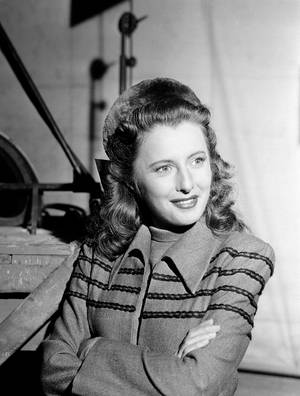 Barbara Stanwyck takes a breather between scenes on the Hollywood lot of Columbia Pictures July 10, 1941.(AP Photo) <strong></strong>