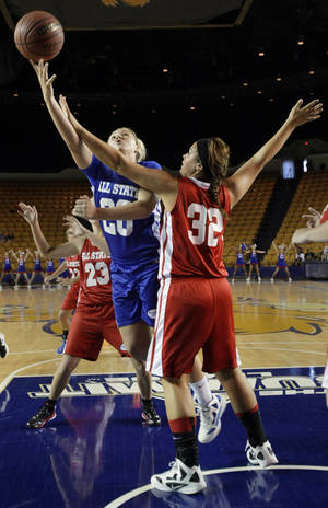 photo - The East&#039;s Kenzie Solberg puts up a shot over the West&#039;s Kori Fast during the All State Small School Girls Basketball game at Oral Roberts University in Tulsa, OK, July 25, 2012. MICHAEL WYKE/Tulsa World