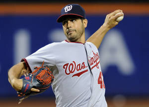 Photo - Washington Nationals pitcher Gio Gonzalez delivers the ball to the New York Mets during the first inning of a baseball game, Monday, Sept. 9, 2013, in New York. (AP Photo/Bill Kostroun)