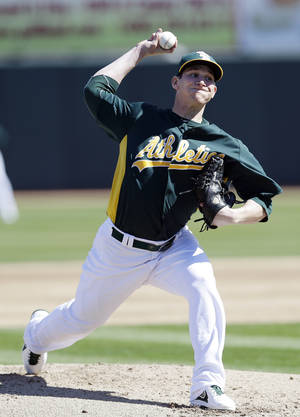 Photo - Oakland Athletics starting pitcher Jarrod Parker throws to the San Francisco Giants during the first inning of an exhibition spring training baseball game on Friday, March 1, 2013, in Phoenix. (AP Photo/Marcio Jose Sanchez)