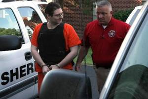 photo - Kevin Sweat (left) is escorted by a sheriff into the Okfuskee County Courthouse, in Okemah, before his preliminary hearing, on Tuesday, May 22, 2012. CORY YOUNG/Tulsa World