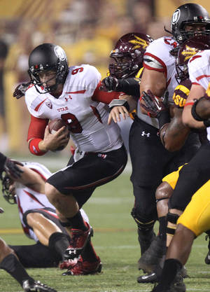photo -   Utah quarterback Jon Hays, left, is hauled down from behind by Arizona State defensive end Davon Coleman, right, in the first quarter of an NCAA college football game, Saturday, Sept. 22, 2012, in Tempe, Ariz.(AP Photo/Paul Connors)  