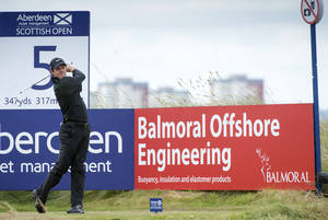 Photo - Rory McIlroy  tees off at the 5th during day one of the Scottish Open at Royal Aberdeen golf course, Aberdeen Scotland Thursday July 10, 2014. (AP Photo/Kenny Smith/PA) UNITED KINGDOM OUT
