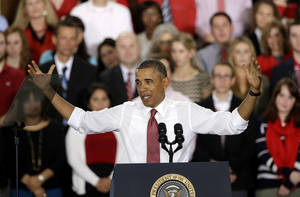 Photo - President Barack Obama gestures as he speaks about the economy, jobs, and manufacturing, Wednesday, Jan. 15, 2014, at North Carolina State Universit in Raleigh, N.C.  (AP Photo/Gerry Broome)