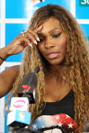 Photo - Serena Williams of the U.S. speaks during a press conference ahead of the Brisbane International tennis tournament  in Brisbane, Australia, Sunday, Dec. 29, 2013. (AP Photo/Tertius Pickard)