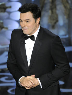 Photo - Host Seth MacFarlane performs onstage during the Oscars at the Dolby Theatre on Sunday Feb. 24, 2013, in Los Angeles.  (Photo by Chris Pizzello/Invision/AP)