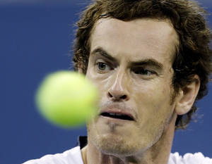 Photo -   Andy Murray, of Britain, returns a shot to Milos Raonic, of Canada, during a match at the U.S. Open tennis tournament, Monday, Sept. 3, 2012, in New York. (AP Photo/Darron Cummings)