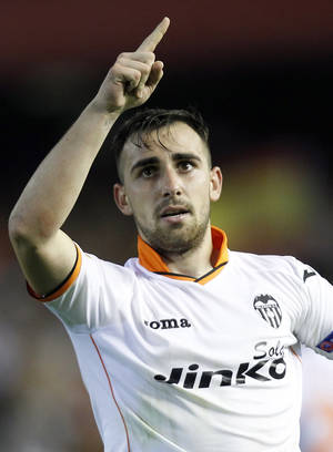 Photo - Valencia's Paco Alcacer celebrates after scoring against Basel during the Europa League quarterfinal, second leg soccer match at the Mestalla stadium in Valencia, Spain, on Thursday, April 10, 2014. Valencia lost 3-0 in the first leg at Basel. (AP Photo/Alberto Saiz)