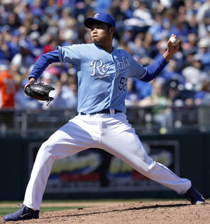 Photo - Kansas City Royals starting pitcher Bruce Chen delivers to a Chicago White Sox batter during the sixth inning of a baseball game at Kauffman Stadium in Kansas City, Mo., Saturday, April 5, 2014. (AP Photo/Orlin Wagner)