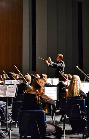 Photo - Peter Markes conducts the Edmond North High School  orchestra. PHOTO PROVIDED