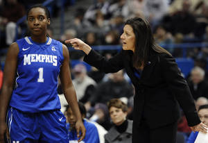 Photo - Memphis coach Melissa McFerrin, right, speaks to Breigha Wilder-Cochran during the first half of an NCAA college basketball game against Connecticut, Wednesday, Jan. 22, 2014, in Hartford, Conn. (AP Photo/Jessica Hill)