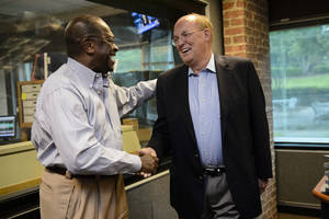 Photo -   Former Republican Presidential candidate Herman Cain shakes hands with news talk radio host Neal Boortz after he was announced as Boortz's replacement following Boortz's retirement announcement during his morning show at News-Talk WSB AM750 in Atlanta, Monday, June 4, 2012. Cain will replace Boortz full-time following inauguration day, January 21, 2013. (AP Photo/Paul Abell)