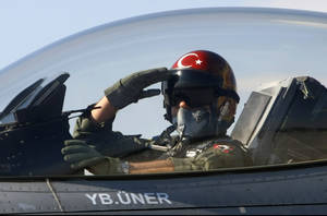"photo -   FILE - In this April 29, 2010 file photo, a Turkish pilot salutes before take-off at an air base in Konya, Turkey. Turkish President Abdullah Gul said Saturday June 23, 2012, his country would take ""necessary"" action against Syria for the downing of a Turkish military jet, but suggested that the aircraft may have unintentionally violated the Syrian airspace. The plane went down in the Mediterranean Sea about 8 miles (13 kilometers) away from the Syrian town of Latakia, Turkey said. (AP Photo/File)"
