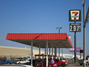 Photo - The 7-Eleven at Interstate 35 and SE 66 displays gasoline at $2.97 a gallon. The citywide average price has dropped 30 cents over the past month. Photo by Adam Wilmoth, The Oklahoman <strong></strong>