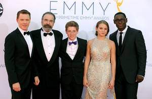 "photo -   The cast of ""Homeland"", from left, Diego Klattenhoff, Mandy Patinkin, Jackson Pace, Morgan Saylor and David Harewood, arrives at the 64th Primetime Emmy Awards at the Nokia Theatre on Sunday, Sept. 23, 2012, in Los Angeles. (Photo by Jordan Strauss/Invision/AP)"