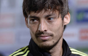 Photo - Spain's David Silva looks on after a press conference at the Atletico Paranaense training center in Curitiba, Brazil, Saturday, June 21, 2014. Spain will play in group B of the Brazil 2014 World Cup. (AP Photo/Manu Fernandez)