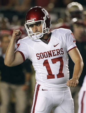Photo - Oklahoma kicker Jimmy Stevens (17) pumps his fist after a 29-yard field goal against Florida State during the second quarter of a NCAA college football game Saturday, Sept. 17, 2011, in Tallahassee, Fla. (AP Photo/Chris O'Meara)  ORG XMIT: TDS116