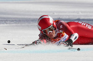 Photo - Switzerland's Dominique Gisin falls in the women's super-G at the Sochi 2014 Winter Olympics, Saturday, Feb. 15, 2014, in Krasnaya Polyana, Russia. (AP Photo/Alessandro Trovati)