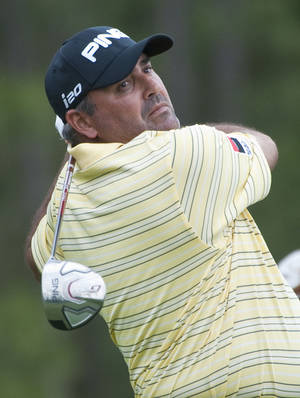 photo -   Angel Cabrera, of Argentina, watches his tee shot on the 13th hole during the first round of the Houston Open golf tournament, Thursday, March 29, 2012, in Humble, Texas. (AP Photo/Dave Einsel)