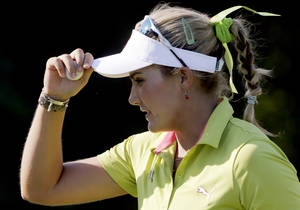 photo -   Lexi Thompson tips her cap after making a birdie on the 17th green during the first round of the Navistar LPGA Classic golf tournament, Thursday, Sept. 20, 2012, at the Robert Trent Jones Golf Trail in Prattville, Ala. (AP Photo/Dave Martin)