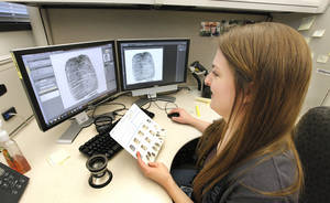 Photo -  Stacy Hirschman, an OSBI criminalist, works in the OSBI Latent Evidence Unit at the Forensic Science Center in Edmond.  <strong>PAUL B. SOUTHERLAND -  PAUL B. SOUTHERLAND </strong>