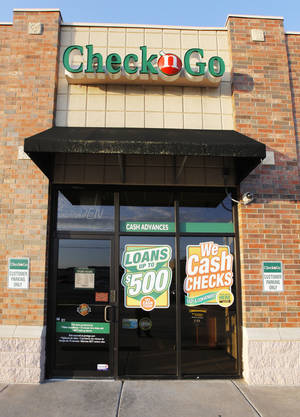 Photo -  A Check 'n Go, 2340 NW 23 Street, store is seen in Oklahoma City.  Photos by Paul B. Southerland, The Oklahoman  <strong>PAUL B. SOUTHERLAND</strong>