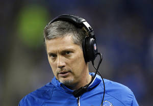 Photo - Detroit Lions head coach Jim Schwartz walks the sidelines during the third quarter of an NFL football game against the New York Giants, Sunday, Dec. 22, 2013, in Detroit. (AP Photo/Paul Sancya)