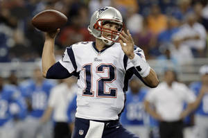Photo - New England Patriots quarterback Tom Brady (12) throws in the first quarter of an NFL preseason football game against the Detroit Lions in Detroit, Thursday, Aug. 22, 2013. (AP Photo/Paul Sancya)