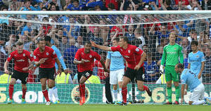 Photo - Cardiff City's Fraizer Campbell,centre left, celebrates scoring his side's third goal of the game against Manchester City during their English Premier League match at Cardiff City Stadium, Cardiff, Wales, Sunday Aug. 25, 2013. (AP Photo/PA, Nick Potts)  UNITED KINGDOM OUT  NO SALES  NO ARCHIVE