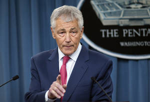 Photo - Defense Secretary Chuck Hagel speaks during a news conference at the Pentagon, Friday, March 15, 2013, to announce that the Obama administration will add 14 interceptors to a West Coast-based U.S.-based missile defense system reflecting concern about North Korea's focus on developing nuclear weapons and its advances in long-range missile technology. (AP Photo/Cliff Owen)