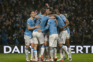 Photo - Manchester City's Edin Dzeko, centre, celebrates with teammates after scoring his second goal against Aston Villa during their English Premier League soccer match at the Etihad Stadium, Manchester, England, Wednesday May 7, 2014. (AP Photo/Jon Super)