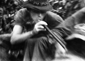 "Photo - FILE - In this file still image made from Nov. 13, 1970, video, soldiers in fire support base Aries, a small clearing in the jungles of War Zone D, 50 miles from Saigon, smoke marijuana using the barrel of a shotgun they nicknamed ""Ralph"" to get high. On the occasion of  ""Legalization Day,"" Thursday, Dec. 6, 2012, when Washington's new law takes effect, AP takes a look back at the cultural and legal status of the ""evil weed"" in American history. (AP Photo/Jim Wells, File)"