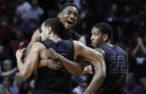 photo - Kansas State's Shane Southwell, center, Angel Rodriguez, left, and Rodney McGruder, right, celebrate after Kansas State defeated Oklahoma 52-50 in an NCAA college basketball game in Norman, Okla., Saturday, Feb. 2, 2013.  Kansas State won 52-50.  (AP Photo/Alonzo Adams)