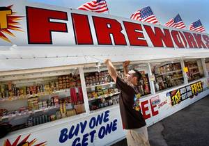 photo - FIREWORKS SALES: Josh Chavez at the fireworks stand he operates with other members of OKC Family Church. The church uses  fireworks sales as a fundraiser for the church. located at 8300 S Shields in Oklahoma City.  Chavez says the church sets up the fireworks stand on the southeast corner of NE 23 and Post Road in Nicoma Park city limits because this is the nearest location to the church where fireworks can be sold legally. He said this is the sixth year the church has opened its stand at the same location. Chavez is an associate pastor at the south Oklahoma City church. He was photographed at the stand Thursday afternoon, June 30, 2011.    Photo by Jim Beckel, The Oklahoman ORG XMIT: KOD