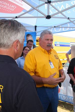 Photo - In this August 2012 photo, Sam Porter, director of Oklahoma Baptist Disaster Relief, talks to volunteers helping victims of the Luther wildfires. Photo provided <strong>PROVIDED</strong>