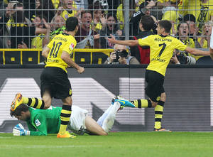 Photo - Dortmund's Jonas Hofmann, right, celebrates the opening goal for his side during a German soccer Bundesliga match between Borussia Dortmund and Eintracht Braunschweig in Dortmund, Germany, Sunday, Aug. 18, 2013. (AP Photo/Michael Probst)