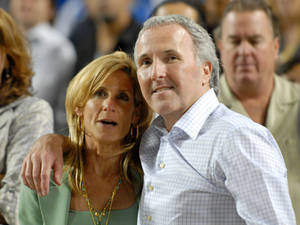 Photo -   FILE - In this Sept. 25, 2008 photo, Los Angeles Dodgers owner and chairman Frank McCourt and his wife Jamie McCourt after the Dodgers' baseball game against the San Diego Padres in Los Angeles. The ex-wife of former Los Angeles Dodgers owner Frank McCourt wants to set aside the couple's divorce settlement, claiming he vastly understated the value of a team that sold earlier this year for $2 billion, the highest figure ever paid for a pro sports franchise. The motion filed Monday Sept. 24, 2012 in Los Angeles Superior Court claims Frank McCourt committed fraud by misrepresenting the couple's Dodgers assets as worth less than $300 million during their protracted divorce. (AP Photo/Carlos Delgado, File)