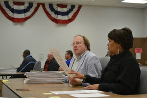 photo - Employees of the Oklahoma County Election Board county ballots manually Wednesday during a recount of the Nov. 6 county sheriff election <strong>The Oklahoman - Zeke Campfield</strong>